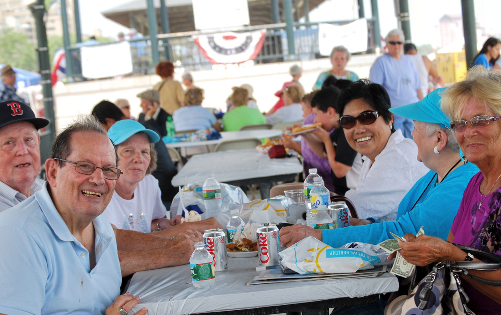 A group of Somerville residents enjoy lunch aboard a Council on Aging boat trip