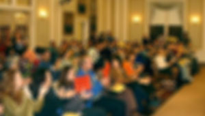 Out-of-focus image of meeting attendees
