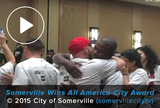 Members of Somerville's All America City team hug in celebration of their victory.