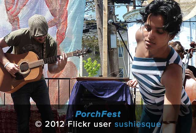 Somerville residents sing and play guitar during PorchFest