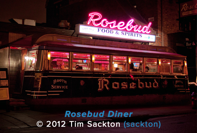 A nighttime shot taken of the Rosebud Diner and its bright neon sign in Somerville
