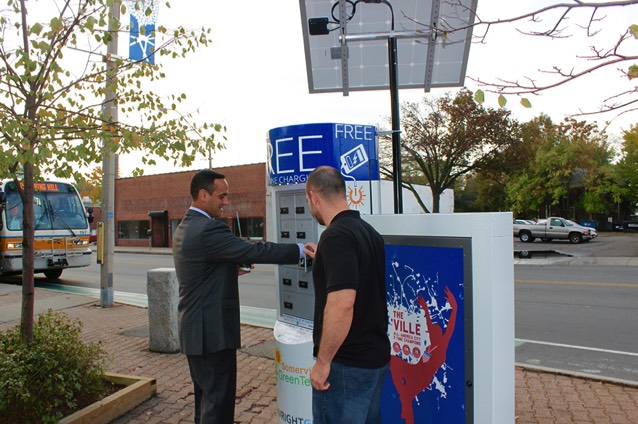 Mayor Curtatone is given a demonstration of the Solar Z cell phone charging locker