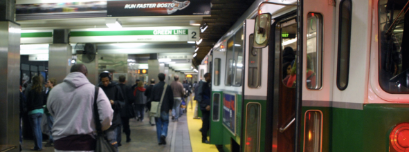 Passengers wait to board on a Green Line platform