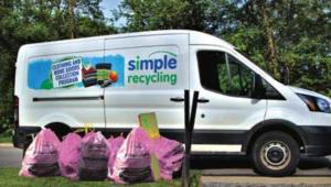 A SimpleRecycling van picks up bags filled with textile donations