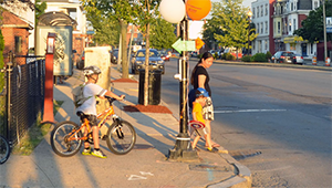 Mother and children cross at a stoplight in Somerville
