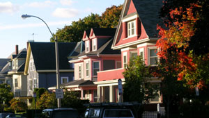 Pink, blue, and green homes sit nestled on Highland Ave.