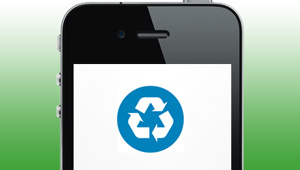 An old smartphone displaying the recycling symbol