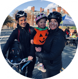 Family wearing bike helmets and Halloween costumes